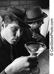 Men drinking at bar. - Two Caucasian prime adult males in...