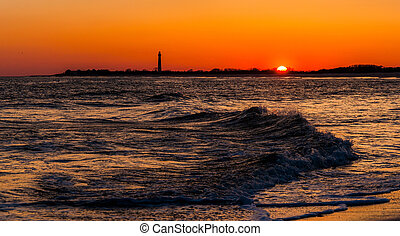 The Cape May Point Lighthouse and waves on the Atlantic at...