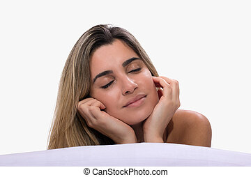 Young woman relaxing on the bed