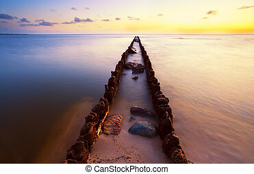 long wooden dike in North sea at sunset, Hindeloopen,...