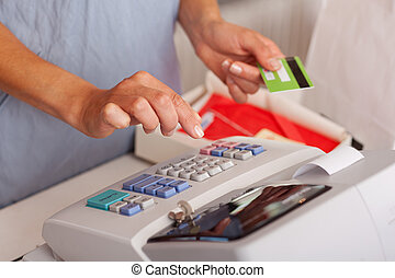 Saleswoman Holding Credit Card While Using Etr Machine -...