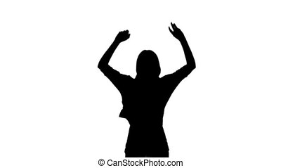 Silhouette of a woman jumping on wh