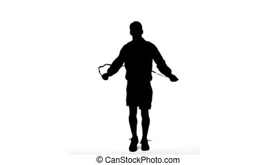 Silhouette of a man working out with a rope on white...