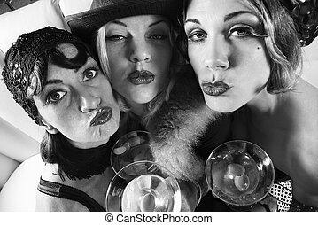 Retro women with drinks. - Three retro prime adult Caucasian...