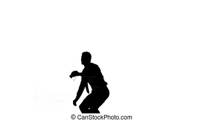 Silhouette of a jumping man turning