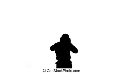 Silhouette of a man jumping and lis