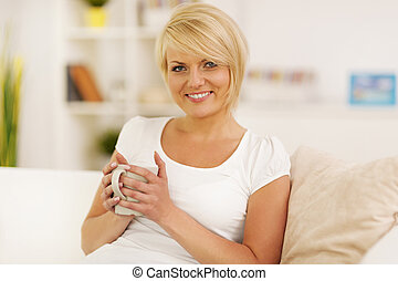 Relaxing at home with coffee