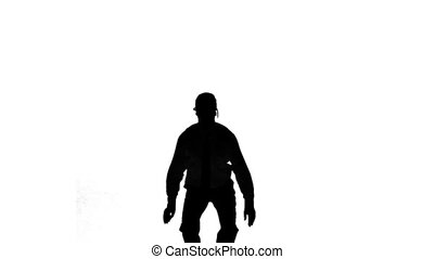 Silhouette of a man jumping with hands on hips on white...