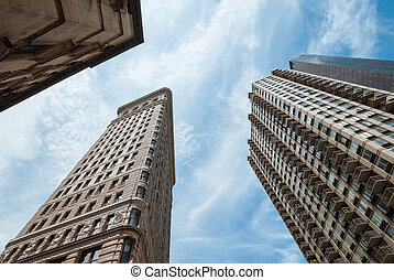 A shot taken from the street, pointing high to sky, showing...