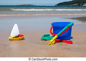 Bucket and spade - Colorful plastic toys: A bucket , beach...