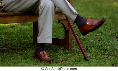 Elderly man sleeping on bench in a park