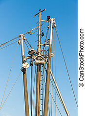 Iron mast with rigging of a fishing ship