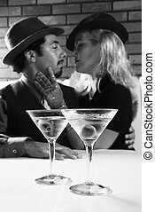 Retro couple with martinis. - Caucasian prime adult retro...