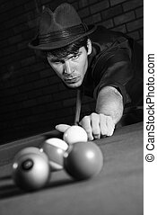 Retro male shooting billiards - Prime adult Caucasian retro...