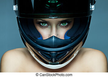 woman in helmet  - Sexy woman in helmet on blue background