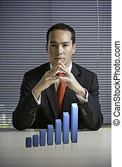 Business man with a 3D growth chart - Asian business man...