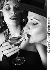 Women drinking alcohol - Caucasian prime adult retro female...