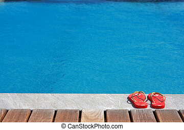 Sandals by the swimming pool