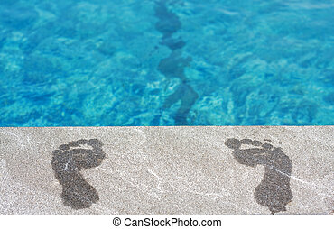 Feet by the swimming pool