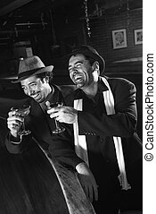 Men laughing and drinking. - Caucasian prime adult retro...