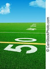 50 yard dreams - 50 yard line with blue sky