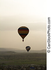 Hot Air Balloons Flying - Hot air balloons flying over the...