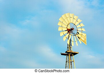 windpower - Old windmill with blue sky and clouds