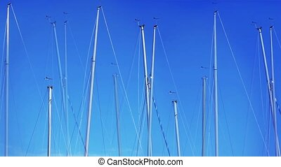 yacht masts - yachts in the harbor. Tripod.