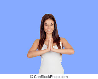 Attractive girl dressed in white practicing yoga
