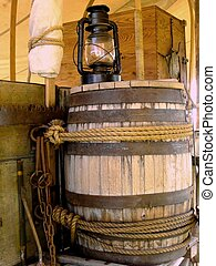 Barrel and Lantern 1 - Water barrel and lantern on covered...