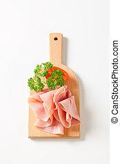 Sliced ham - Thinly sliced ham on cutting board
