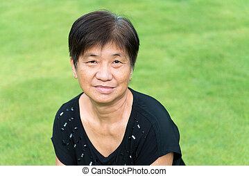 Asian senior citizen - Asian elderly woman smilling in the...