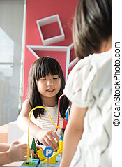 Child playing toy - Little Asian girl playing toy with...