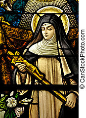 Stained Glass window of St Monica holding the cross of Jesus...