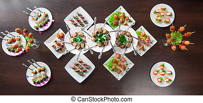 Lots of delicious nourishing appetizers on table, close-up