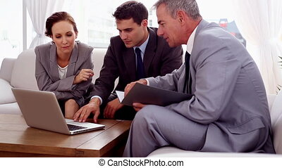 Business people on a couch working