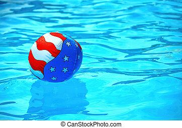patriotic beach ball in pool - Flag design on a beach ball...