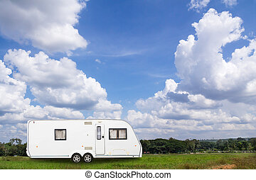 Caravans camping in the park with blue sky