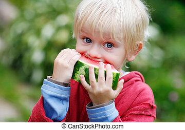 Melon Munching - Picture of young boy and a slice of...
