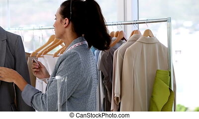 Fashion designer working on a jacket in her studio