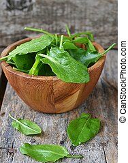 fresh green sorrel in to the bowl