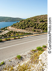 winding road in deserted landscape in vis island