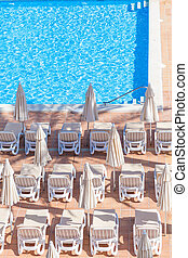 Pool side - sun loungers by pool