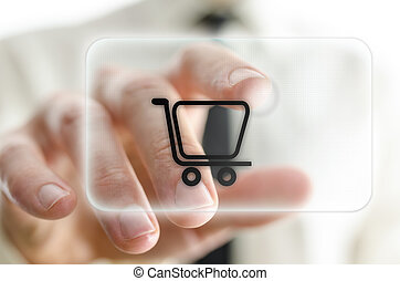 Online shopping - Male han pressing shopping cart on virtual...