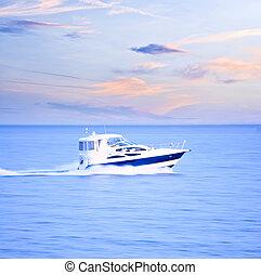 Speedboat at dusk, panning shot, in-camera motion blur