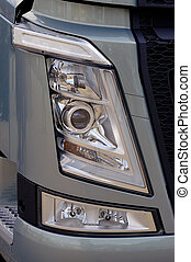 close-up on a headlight of new truck
