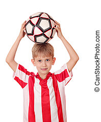boy holding a soccer ball above his head