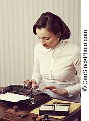 Woman typing in her office - Retro business woman typing in...