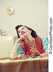 Housewife dreaming - Vintage portrait of a happy housewife...