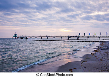 pier at Baltic Sea - pier at sunrise at the Baltic Sea